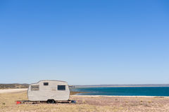 Lonely trailer by the shore Stock Photography