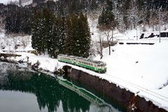 A lonely train is going to a snowy village stock photography