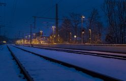 Lonely train station in winter at night. Lonely train station in Tutzing in winter at night, Bavaria, Germany, Europe royalty free stock photos