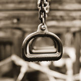 Lonely Trapeze Rings. Rusted and dew-draped rings hang still and silent in an abandoned playground Royalty Free Stock Photo