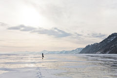 Lonely traveler on Baikal surface Stock Photos
