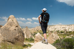 Lonely traveler looking to Cappadocia rocks Stock Image