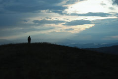 Lonely traveller across the mountains Stock Image