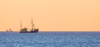 Lonely trawler boats at dusk Royalty Free Stock Image