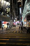 Hong Kong commercial district Streets By night. Lonely tree over blue sky near lake and green field Stock Photos