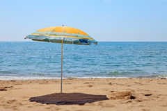 Lonely umbrella on the beach Royalty Free Stock Image
