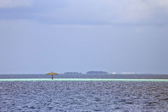 Lonely umbrella in the ocean Stock Photos