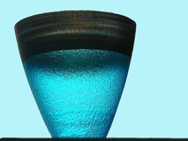 Lonely Vase. A huge turquoise blue vase made of glass looking beautiful with the sky's reflection Stock Photo