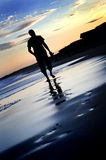 Lonely walk. Lonely evening walk on the beach stock photo