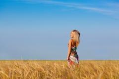 Lonely walking on wheat field Stock Photo