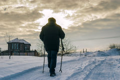 Lonely wanderer on a snowy road Royalty Free Stock Image