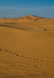 Lonely ways. Erg Chebbi is one of Morocco's two Saharan ergs – large dunes formed by wind-blown sand –. The other is Erg Chigaga near M'hamid. Its Royalty Free Stock Photos