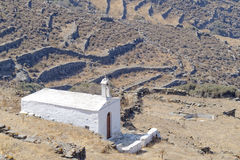 Lonely white church on mountain slopes Royalty Free Stock Image