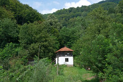 Lonely white, traditional house in the woods, Serbia Royalty Free Stock Image