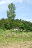 Lonely white, traditional house in the woods, Serbia Royalty Free Stock Photography