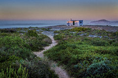 Lonely whitw House on the hill. House on the hill over looking Langebaan lagoon at sunrise Stock Images