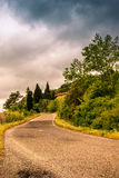 A lonely winding road on the hills of Tuscany - 2. A lonely winding road on the hills of Tuscany royalty free stock images