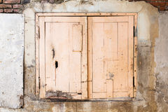 Lonely window on the brick wall of an old building Royalty Free Stock Images
