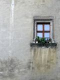 Lonely window. Isolated window on a shabby medieval wall Stock Images