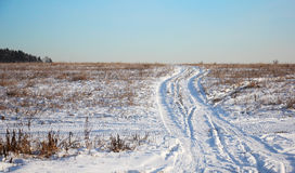 Lonely winter road in a field, in the form of zigzag Stock Photo
