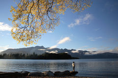 Lonely Woman. A Woman enjoying New Zealand landscape, Queenstown Royalty Free Stock Photos