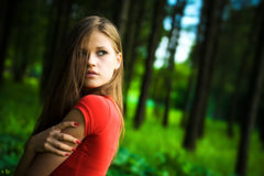 Lonely woman. In a forest Stock Photo