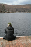 Lonely Woman. On the Lake Deck royalty free stock photography