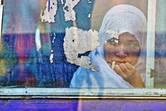 Lonely. Woman in Bangladesh staring out of the window of a bus Stock Photography