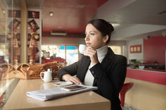 Lonely woman at the bar Stock Image