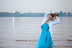 Lonely woman on the beach Royalty Free Stock Image