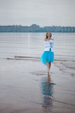 Lonely woman on the beach Royalty Free Stock Photo