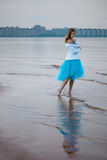 Lonely woman on the beach Royalty Free Stock Photography