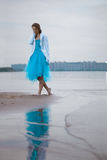 Lonely woman on the beach. Beautiful, lonely woman on the beach royalty free stock images