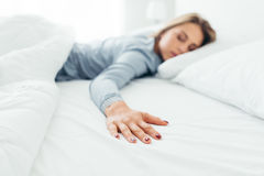 Lonely woman in bed Stock Photography