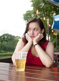 Lonely woman with beer. Depressed young woman with beer stock image