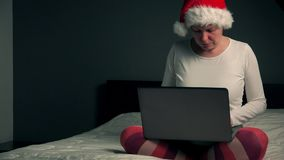 Lonely woman browsing internet on Christmas eve stock video