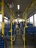 Lonely woman on the bus Stock Photo