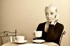 Lonely woman in cafe. Stock Image