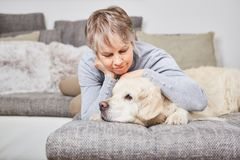Lonely woman cuddles with dog Royalty Free Stock Images