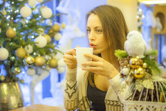 Lonely woman drinking coffee. In coffee shop Royalty Free Stock Photo