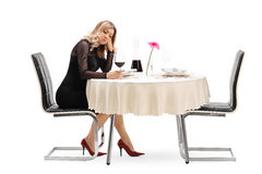 Lonely woman drinking wine Royalty Free Stock Image
