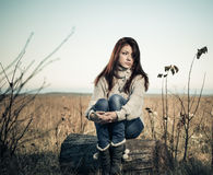 Lonely woman at fall meadow Stock Photos