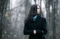 Lonely woman in a forest Stock Image