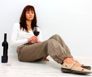 Lonely woman on the floor Stock Images