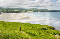 Lonely Woman Hiker on a Clifftop Path and Cloudy Sky Stock Image