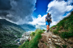 Lonely woman hiker in a path. Lonely woman hiker in a mountain path Stock Image