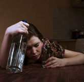Lonely woman holding alcohol bottle and glass Stock Image