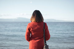 Lonely woman. Looking at the sea Stock Image