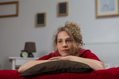 Lonely woman lying on bed Stock Photography