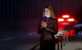 Lonely woman posing at dark highway Stock Image
